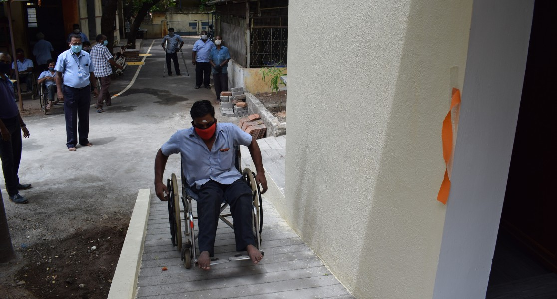 A person in wheel chair entering the Block